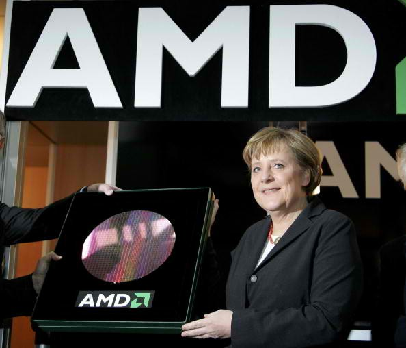 German Chancellor Angela Merkel presents one of the first 300 mm wafer of the AMD factory in Leipzig at CeBIT.