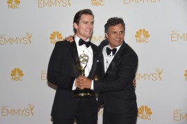 Actor Matt Bomer (L) and Mark Ruffalo, winners of the Outstanding Television Movie for 'The Normal Heart' pose in the press room during the 66th Annual Primetime Emmy Awards held at Nokia Theatre L.A. Live on August 25, 2014 in Los Angeles, California.