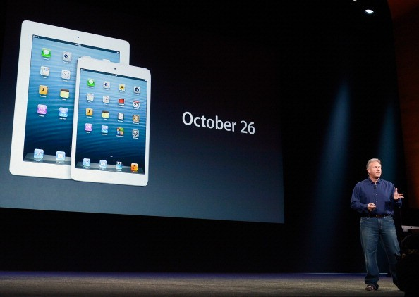 Apple Senior Vice President of Worldwide product marketing Phil Schiller displays the date when the new iPad mini and fourth generation iPad will be available to the public during an Apple special event at the historic California Theater on October 23, 20