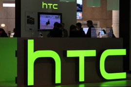 Logos sit illuminated at the HTC Corp. pavilion during the Mobile World Congress at the Fira Gran Via complex in Barcelona, Spain on February 27, 2014.