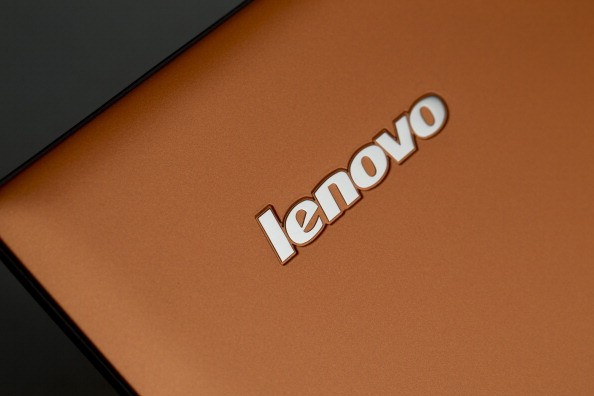 A Lenovo Group Ltd. logo is displayed on a IdeaPad Yogo 2 Pro as it sits on display in this arranged photograph at a Lenovo store in the Sha Tin district of Hong Kong, China, on Friday, Feb. 7, 2014. Lenovo, which has headquarters in Beijing and Morrisvil