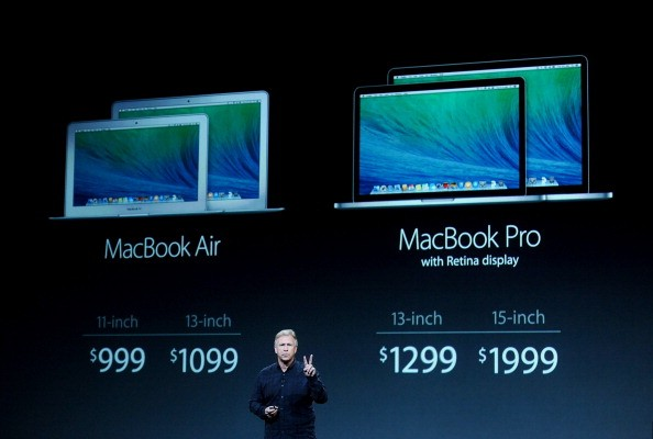 Philip Schiller, senior vice president of worldwide marketing at Apple Inc., unveils the MacBook Air and MacBook Pro laptops during a press event at the Yerba Buena Center in San Francisco, California, U.S., on Tuesday, Oct. 22, 2013. Apple Inc. is expect