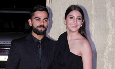 Indian cricketer Virat Kohli (L) and actress Anushka Sharma pose for a photograph during designer Manish Malhotra's 50th birthday in Mumbai on December 5, 2016.
