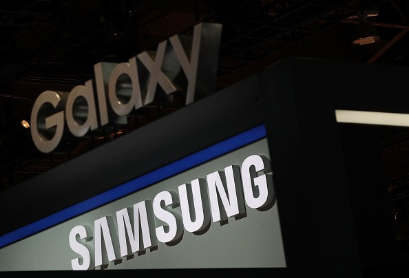 A Samsung and a Galaxy signs are seen at the Samsung booth during CES 2017 at the Las Vegas Convention Center on January 5, 2017 in Las Vegas, Nevada.