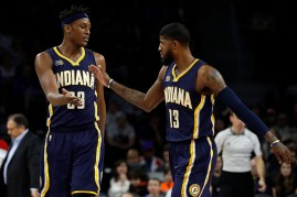 Indiana Pacers players Myles Turner (L) and Paul George
