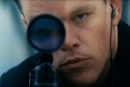 Jason Bourne aiming a rifle in a scene from the 2016 movie 'Jason Bourne'.